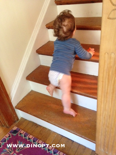 how to encourage baby to stand independently